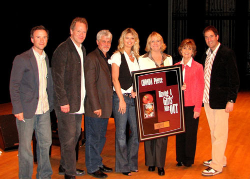 Chonda Pierce Receives A Plaque Commemorating Her RIAA Certified Platinum DVD Award On The Victory Theatre Stage In Evansville IN